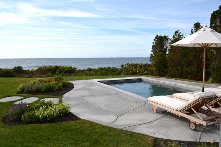 Woodbury Gray granite coping and large custom cut pavers create this pool patio design in Rye, NH