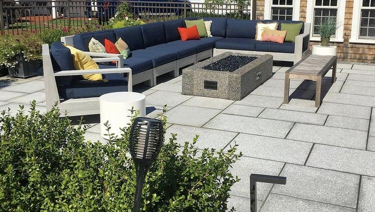 Woodbury Gray granite patio with Calendonia granite fire pit. Project by Seoane Landscape Design