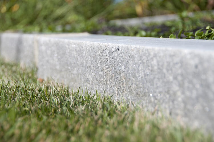 Detailed view of Swenson's Concord Gray granite curb