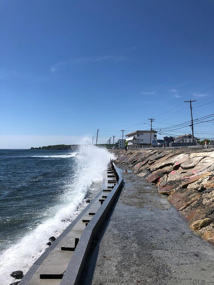 Seawall featuring Concord Gray granite in York, Maine. Project by LaBrecque Construction Inc.