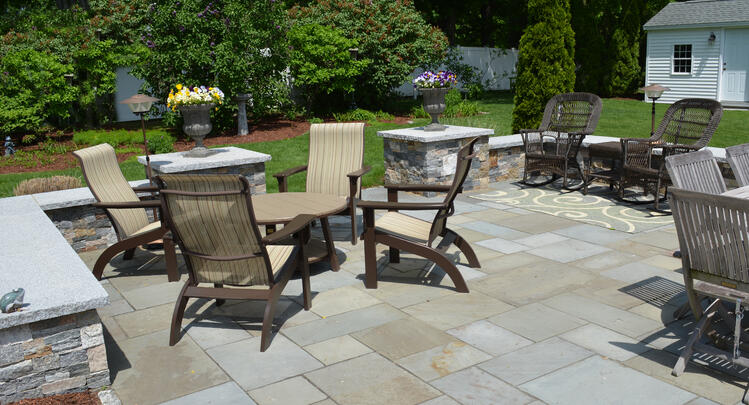 Patio featuring natural stone and granite. Project by Northern Lights Landscape Contractors.