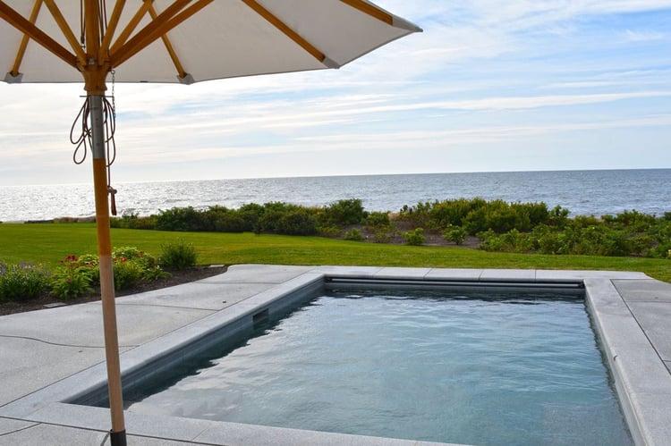 Woodbury Gray granite coping and custom-cut pavers beach house oceanfront pool
