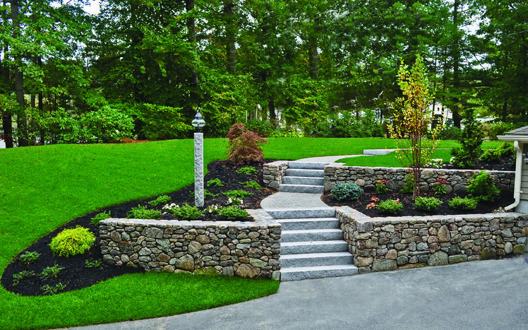 New England-style wallstone and Woodbury Gray granite steps
