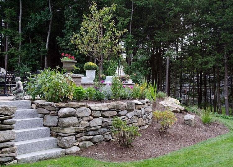 Backyard retreat with Woodbury Gray steps and natural stone wall