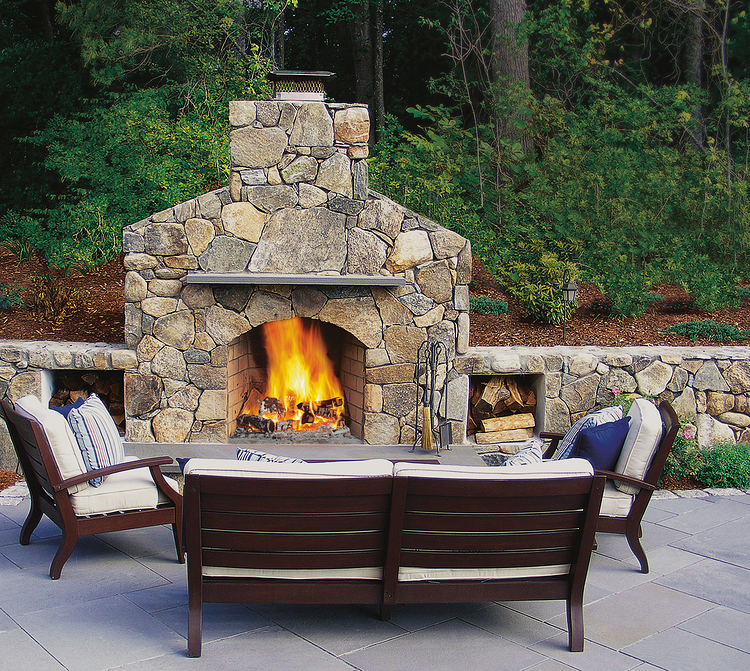 Natural stone outdoor fireplace with bluestone hearth and mantel
