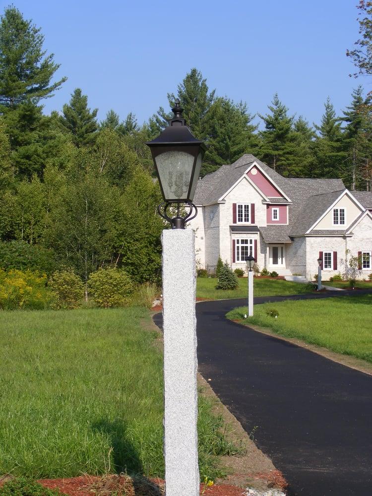 Woodbury Gray granite lamp post bordering driveway