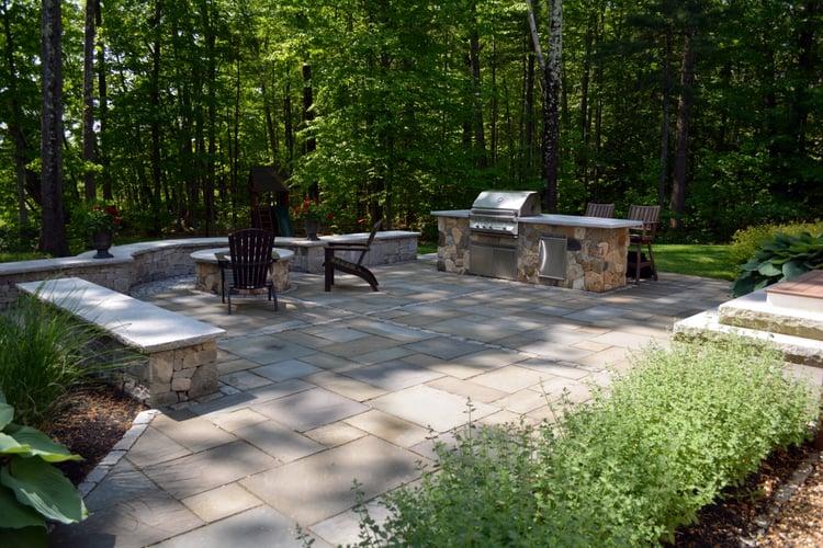 A backyard retreat in Hollis, NH featuring Woodbury Gray granite  and bluestone