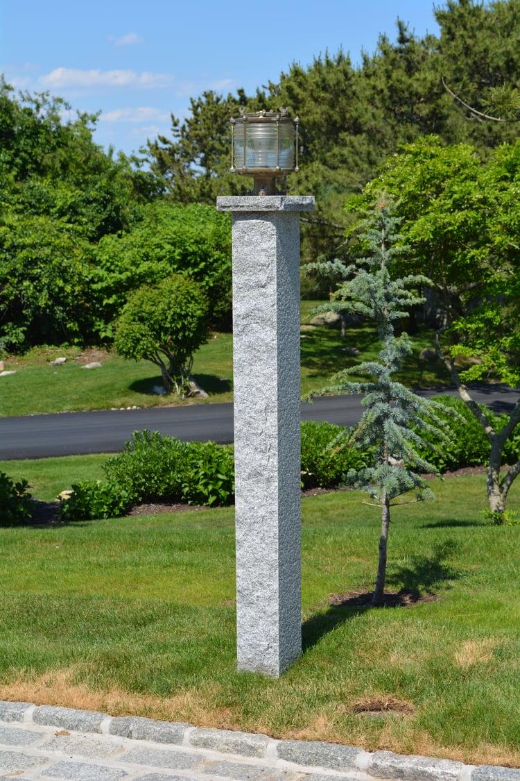 Woodbury Gray granite lamp post with an salvaged ship light