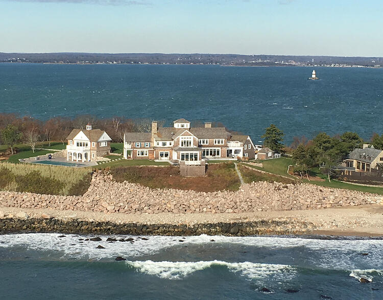 Fishers Island oceanfront home renovated with granite and bluestone