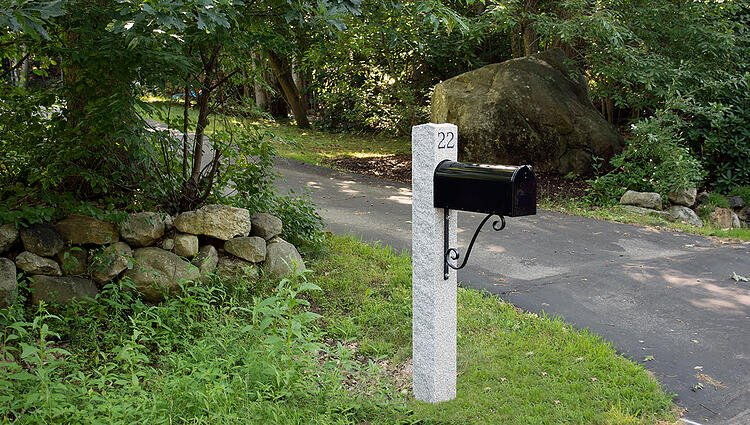 Durable granite mailbox post installed and engraved with address number