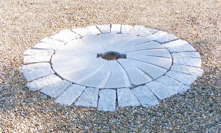 Woodbury Gray granite millstone and cobblestones