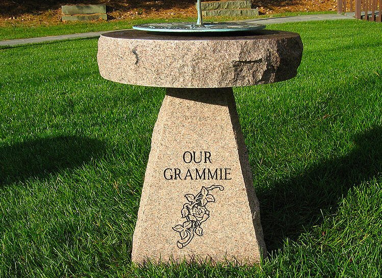 Autumn Pink granite sundial base with a bronze sundial