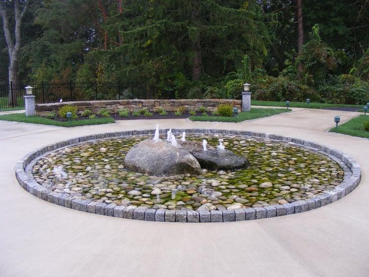 Landscape cobblestones edge water feature