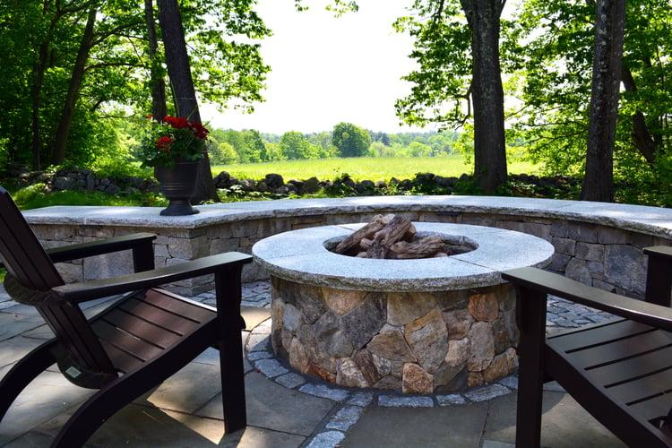 Granite cobblestones integrated into patio with fire pit