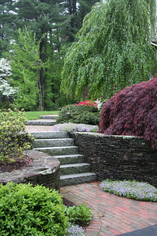Woodbury Gray granite steps and weathered fieldstone -- project by Ahronian Landscaping