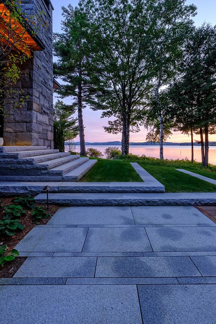 Swenson Woodbury Gray granite pavers, steps and a two turf landing
