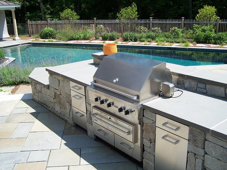 Natural stone poolside outdoor kitchen