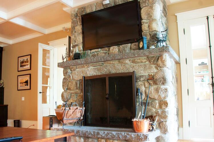 Natural stone fireplace Caledonia granite hearth and mantel