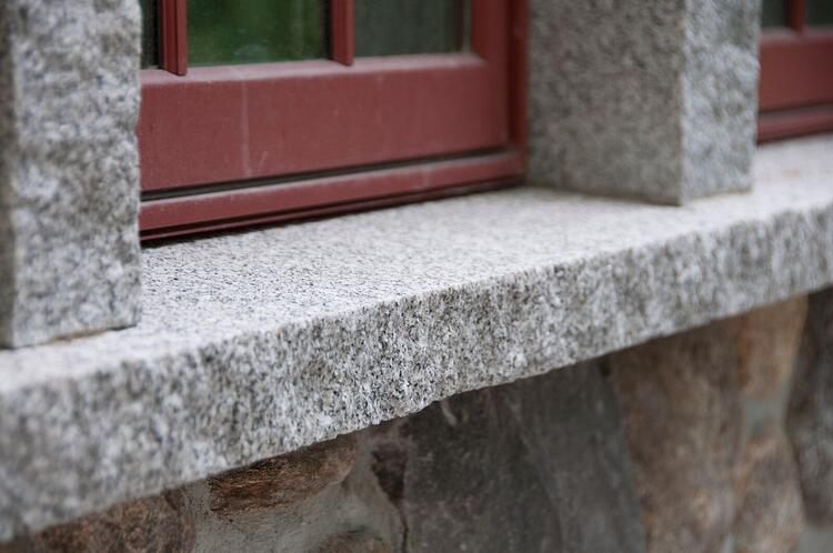 Granite header supports and window sill