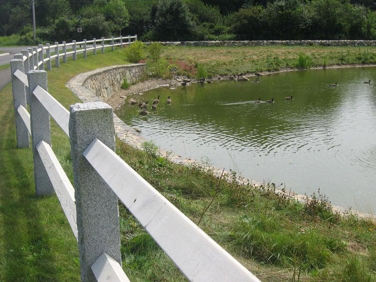 Woodbury Gray Granite fence around pond