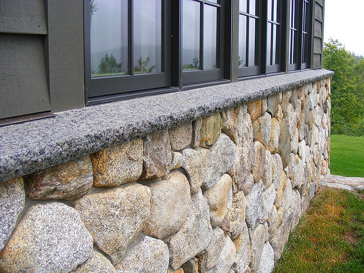 Granite water table on home exterior