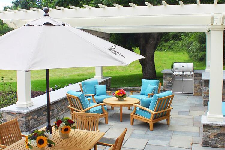 Outdoor kitchen and patio with natural stone