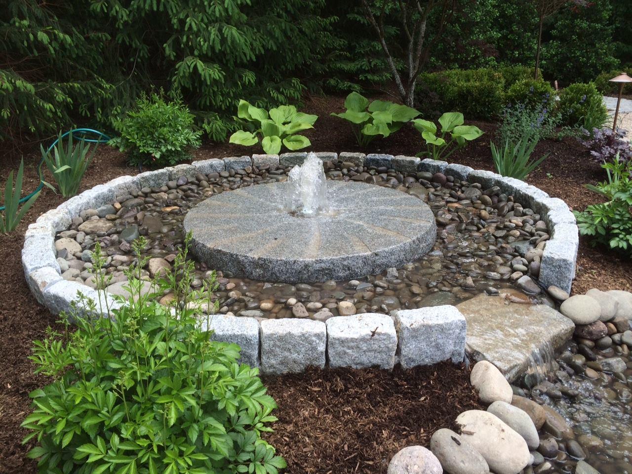Swenson Granite Works cobblestone and millstone fountain
