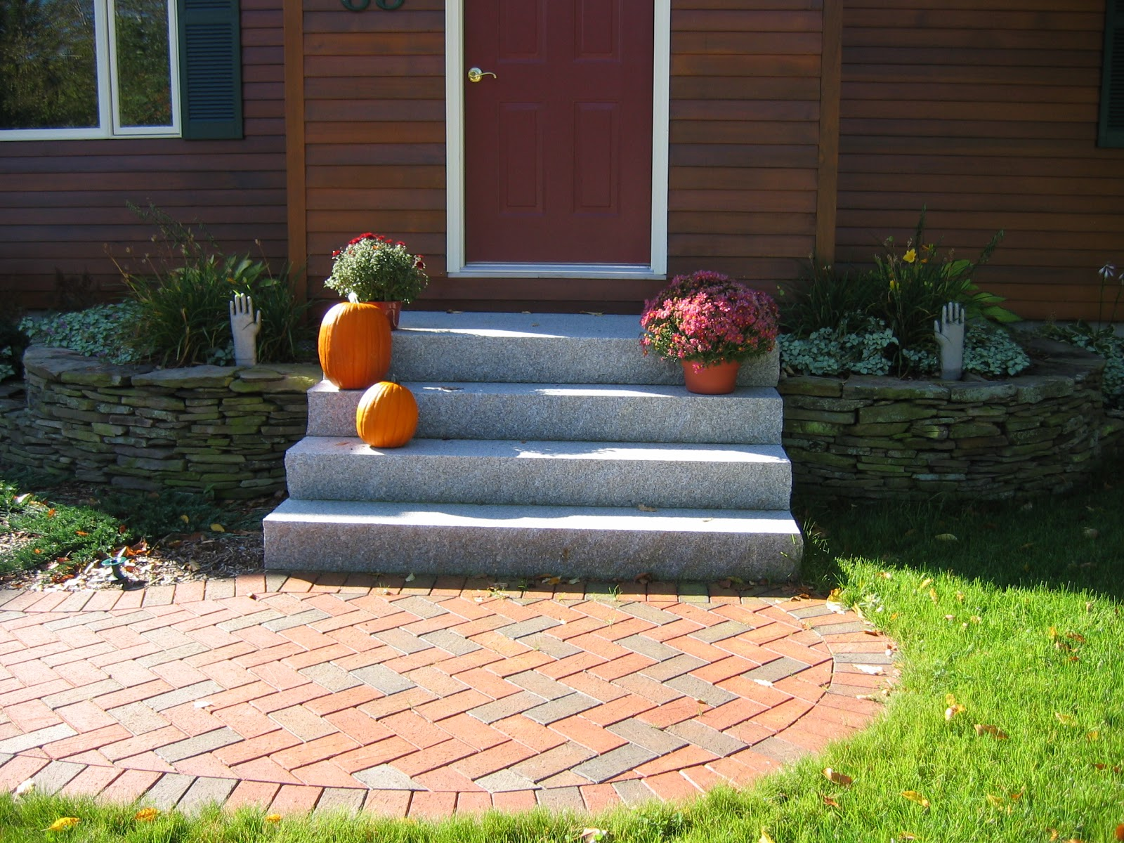 Woodbury Gray granite steps and a weathered fieldstone decorative wall
