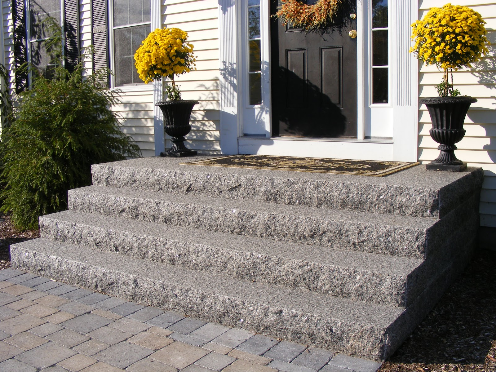 Gold chrysanthemums and Caledonia granite steps