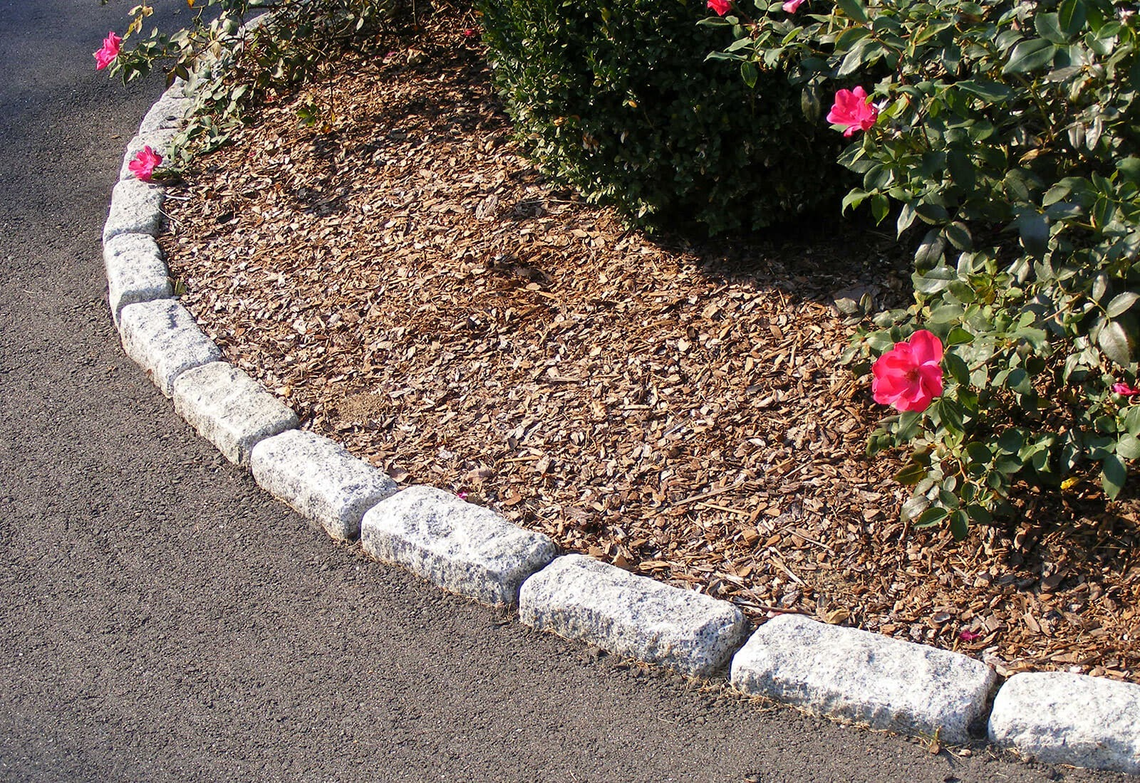 Standard granite cobblestones edge the planter bed