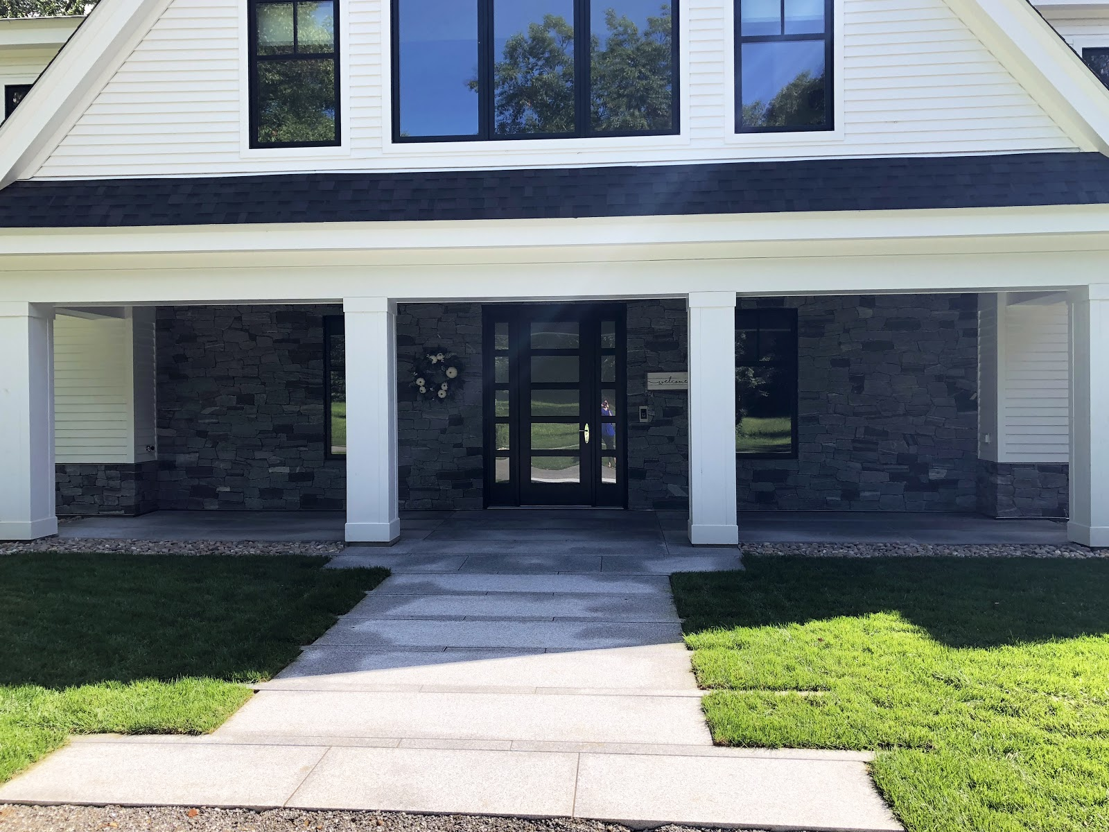 Front of home photo incorporating Swenson granite along the walkway