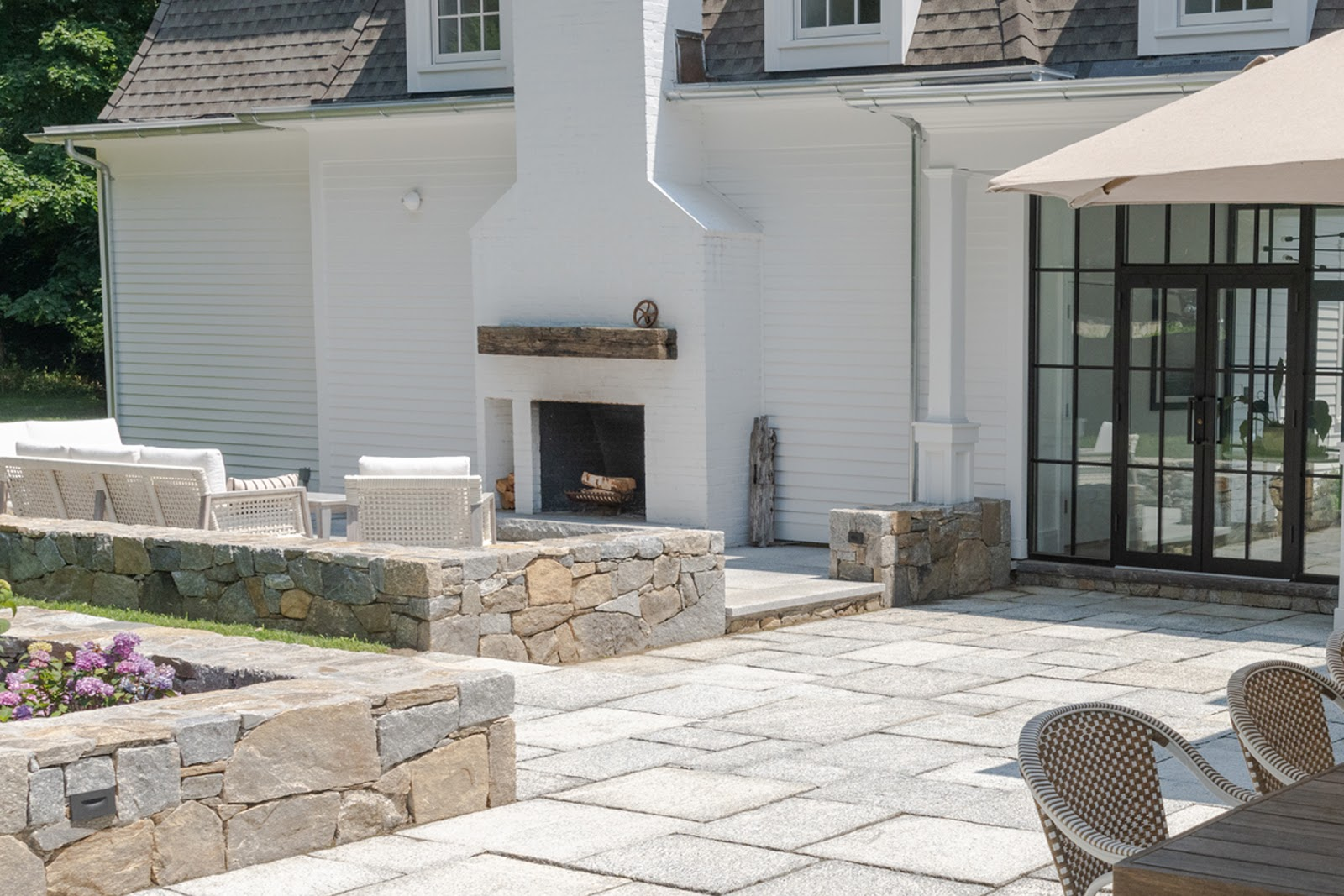 Eva Amurri Historic Connecticut Home Renovation Outdoor Living Space with Granite and Natural Stone