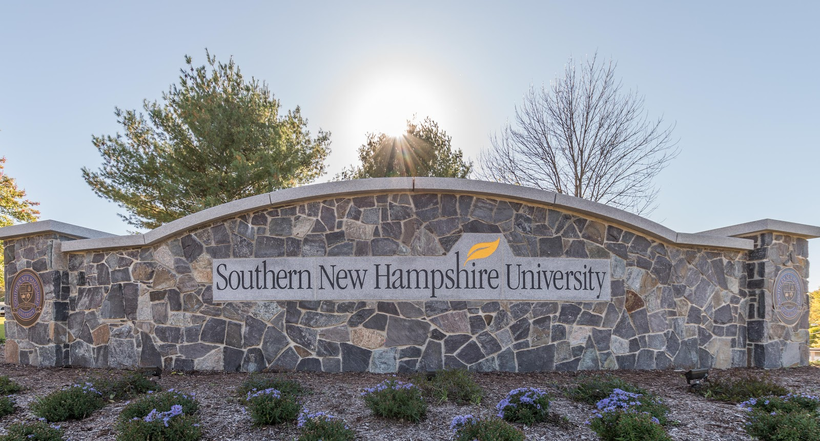 Swenson Granite Works provided WOODBURY GRAY™ granite for both the granite cap and the engraved panel of one of Southern New Hampshire University's first entry signs