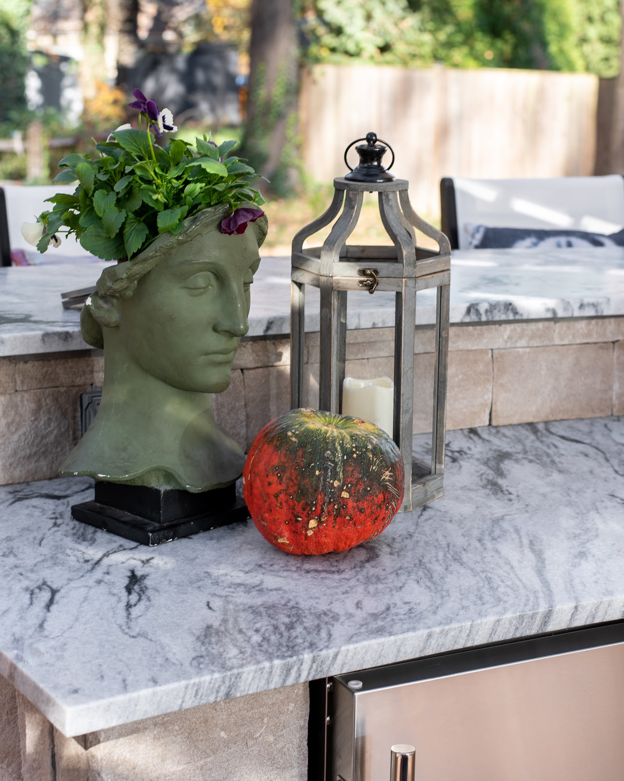 Photo of Pearl Grey marble countertops in the outdoor kitchen space
