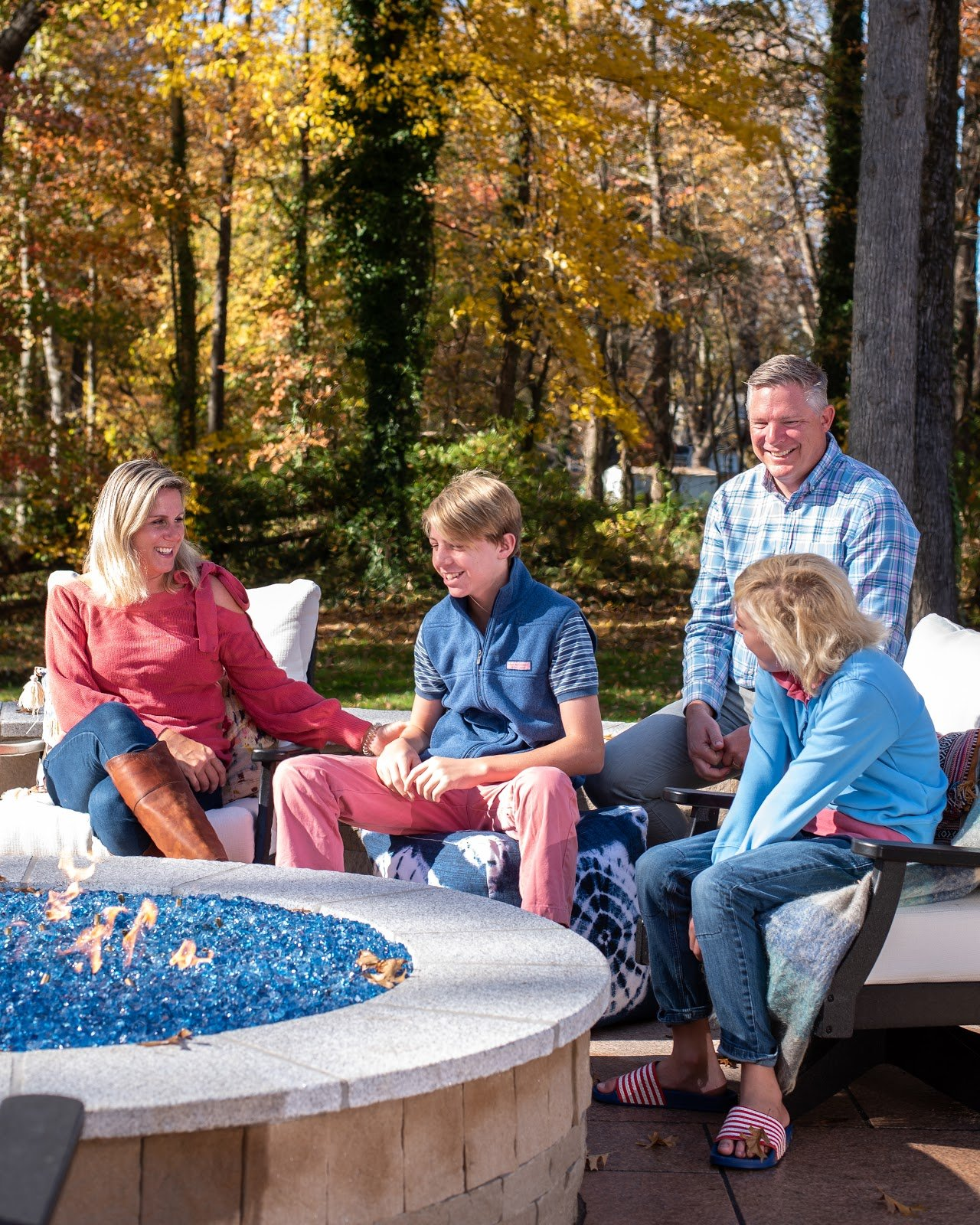 photo of the family around the fire pit