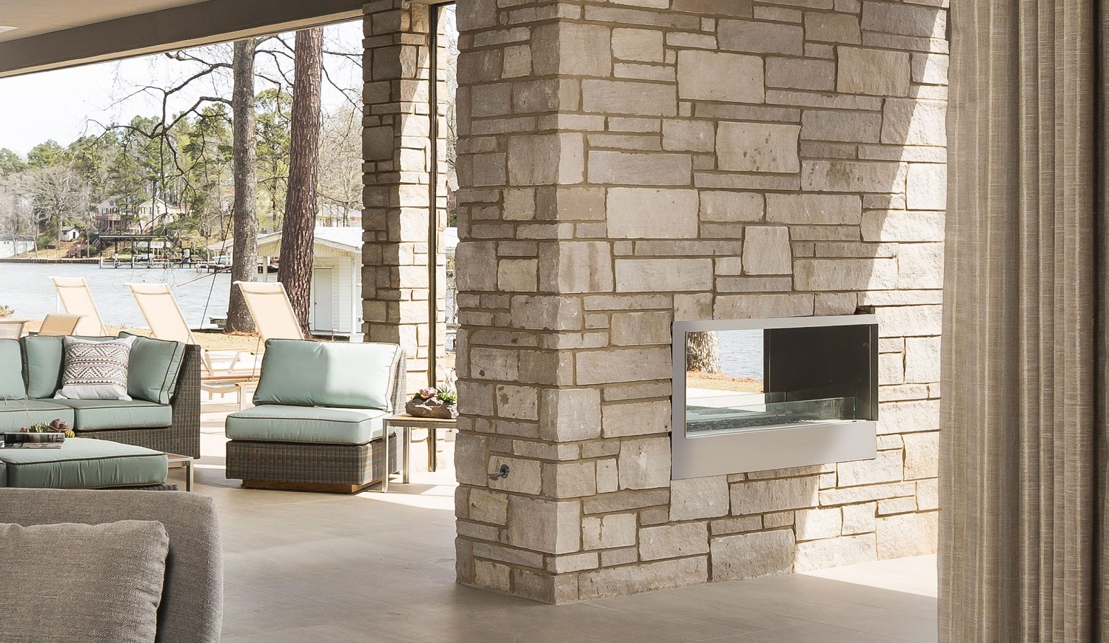 A contemporary outdoor fireplace crafted from Berkshire™ Indiana limestone veneer