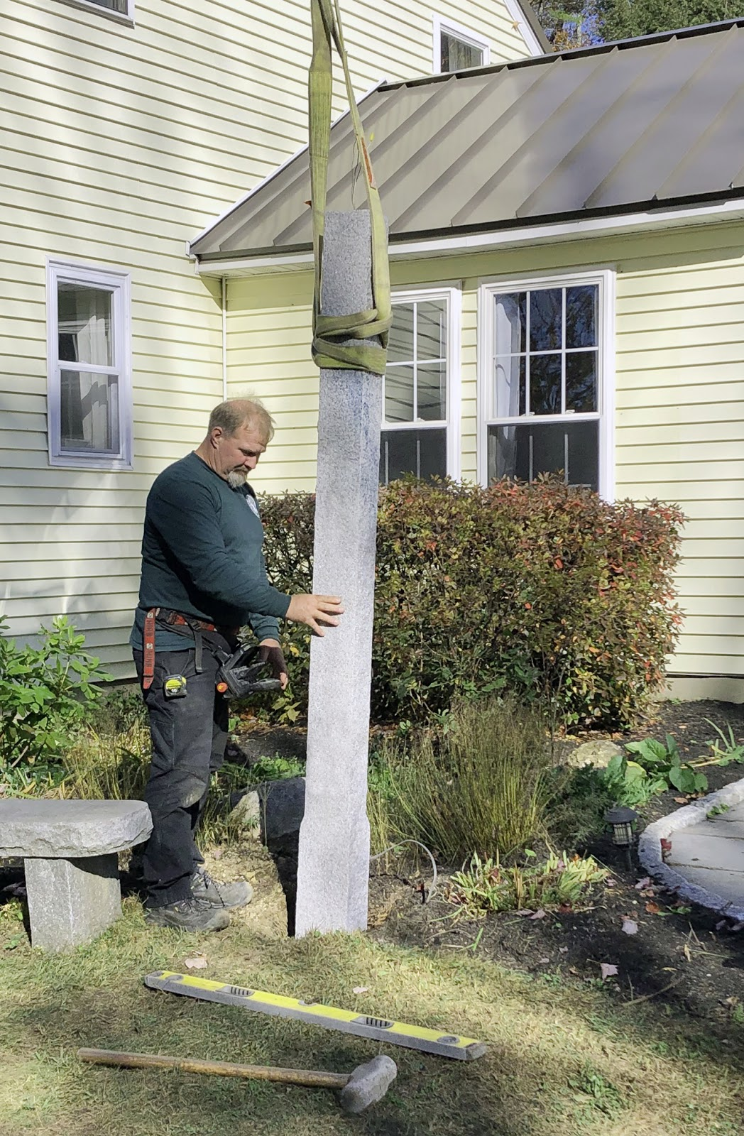 Installing a granite lamp post from Swenson Granite Works