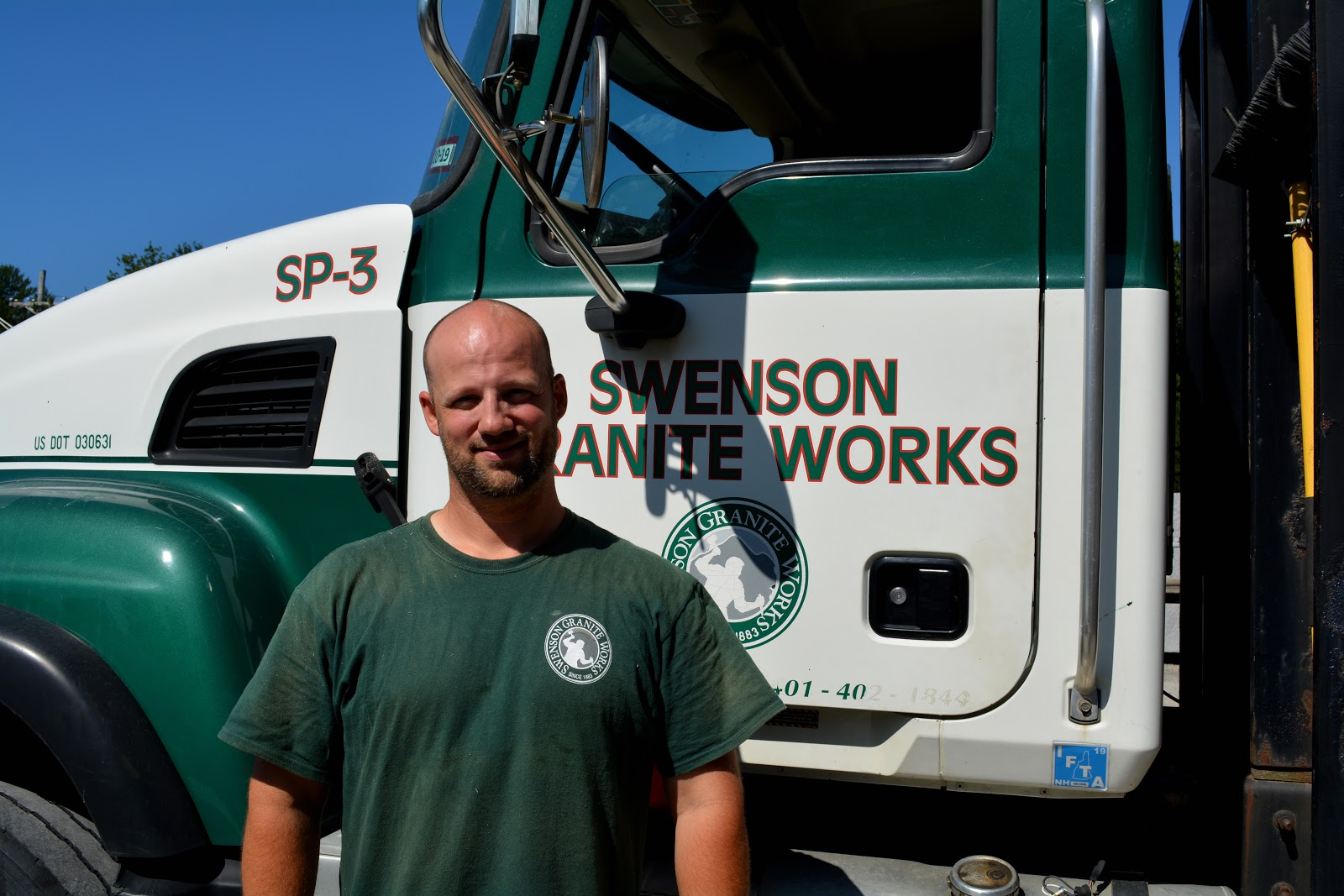 Chuck Marchetti in front of the Swenson Granite Works truck