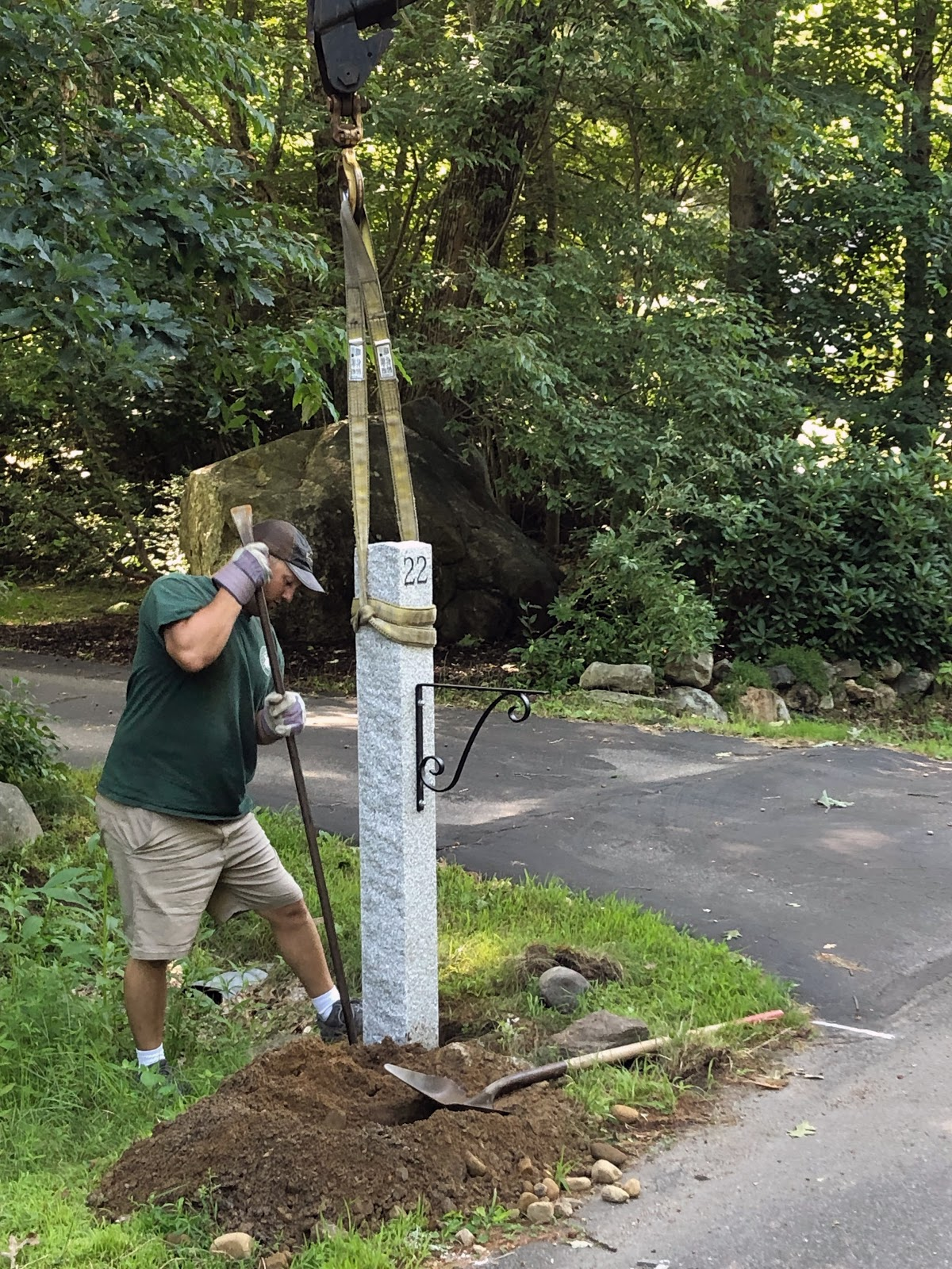 Installing a granite mailbox post from Swenson Granite Works