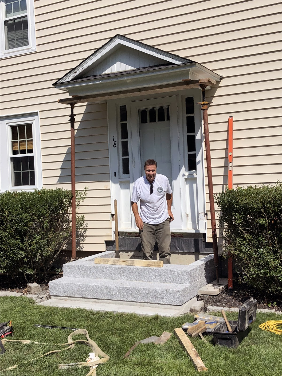 Installing a set of granite steps from Swenson Granite Works
