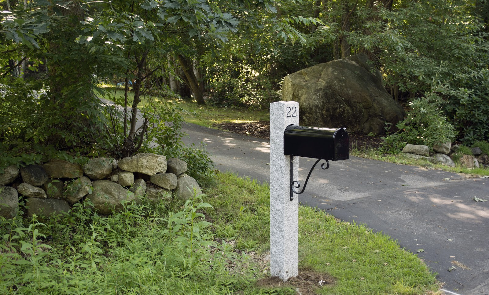 A granite mailbox post from Swenson Granite Works